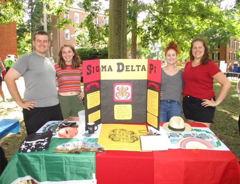 Vinny Lyons, Suzy Aftabizadeh, Rory O'Malley and Maggie Saine enjoyed raffling off some prizes at the Student Involvement Fair their first weekend on campus for Fall 2019.