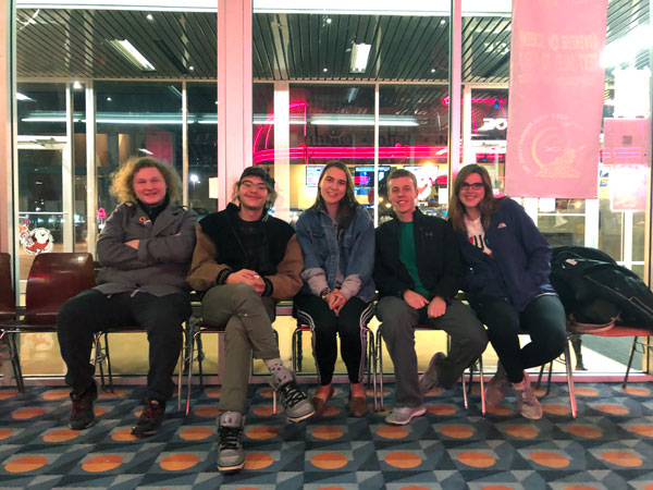 Spanish Club at Athena Grand. 5 students pose in the theater lobby before the movie